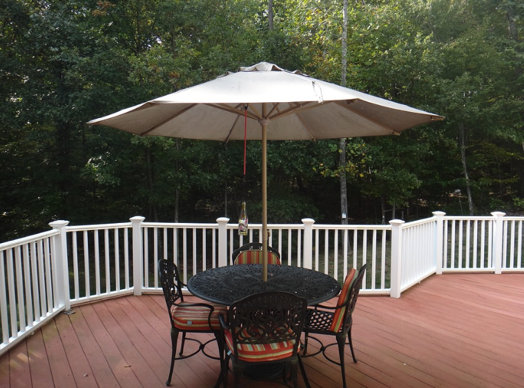 Table, Chairs, and Umbrella on a Deck